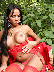 Shemale with big tits offers herself in red lingerie