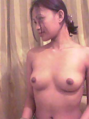 Photos of Oriental cuties posing in the nude