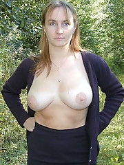Pictures of a big-tittied MILF posing naked