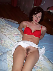 Pictures of a hot wife displaying her pussy