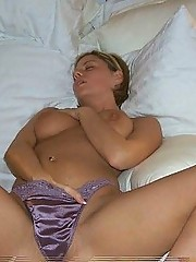Sexy busty MILF plays with self on her bed