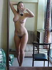 Blonde chick with bush shows off nice tits