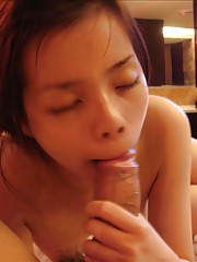 A horny Asian chick sucking cock at different times