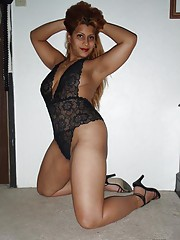 Chubby Latina spread on the floor in black lingerie