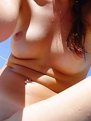 very hot girl takes pictures of her spread kooch at a nude beach