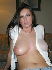busty brunette in a white shirt with wet tits