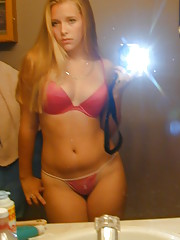 Hot teen poses in the mirror showing her nice tits