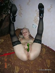 Photos of a sleazy honey fucking her holes with a cucumber