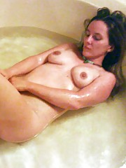 Photo selection of a naked housewife in a bath tub