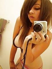 Picture set of an amateur selfshooting big-tittied teen