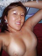 Photo gallery of a sexy Asian GF showing off her breasts