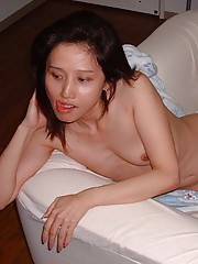 Photo collection of a horny Oriental chick in a motel
