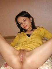 Photo collection of Asian bitches showing their cunts