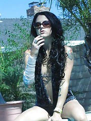 Photo gallery of an amateur tattooed rocker GF by the pool