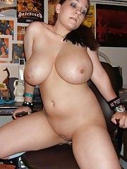 Photo set of a plumper showing her huge breasts