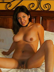 Latina with sexy body poses naked in her bed