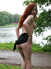 Lucky passers-by watch a sweet redhead pose nude