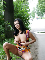 Hot babe flashes tits and spreads buns in the park