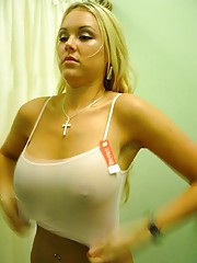 Big tittied blonde stripping and trying on clothes