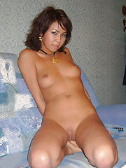 A really cute horny Chinese girl spreads her legs for the camera