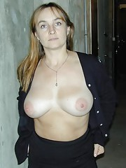 Busty MILF sucking and showing off