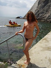 Shaved sexy nudist redhead MILF posing outdoors