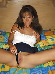 Photo gallery of a slutty amateur wife spreading