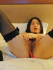Gallery of a wild Chinese babe in stockings and heels