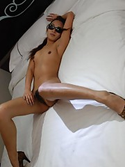 Naked Korean chick in sleazy poses in the bedroom