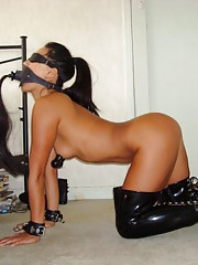 Asian fucktoy in kinky bondage gets a dildo up her ass