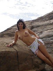 Sexy busty Latina honey posing naked outdoors