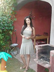 Picture collection of steamy hot Latina babe showing her tits