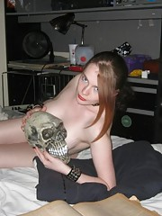 Kinky gothic chick posing topless in her bedroom