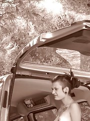Punk girlfriend posing topless while camping with BF