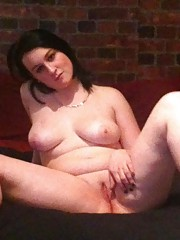 Naked chubby brunette spreading her smooth pussy in bed