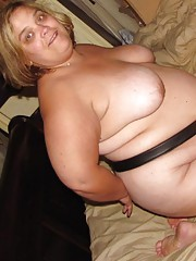 Nasty BBW playing with dildos including a strap-on