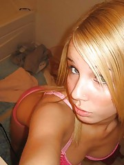 Hot topless blonde selfshooting in the bathroom