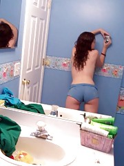 Sexy brunette teen selfshooting in the bathroom