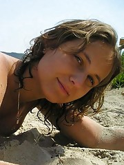 Picture collection of an amateur sexy topless hottie posing outdoors